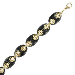 Pulsera de oro en color negro. Con adornos en resina