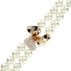 Pulsera de oro en color cristal. Con perlas, cristales