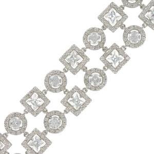 Pulsera de oro blanco en color cristal. Con circonitas, cristales