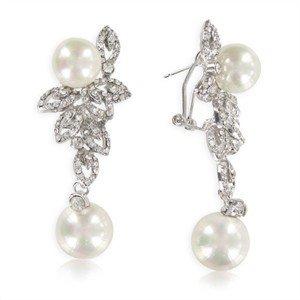 Pendientes de oro blanco en color cristal. Medianos-largos. Con perlas, circonitas